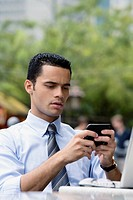 Close_up of a businessman using a personal data assistant