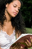 Close_up of a teenage girl reading a book