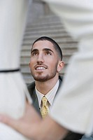 Businessman smiling and looking up (thumbnail)