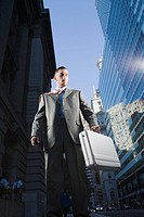 Low angle view of a businessman holding a briefcase (thumbnail)