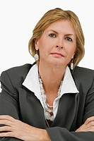 Close_up of a businesswoman thinking with her arms crossed