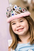 Close_up of a girl wearing a crown and smiling