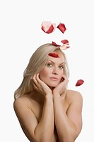Rose petals falling on a young woman (thumbnail)