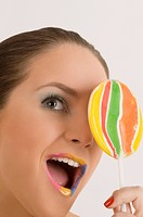 Close_up of a young woman holding a lollipop