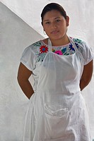 Portrait of a young woman standing with her hands behind her back, Papantla, Veracruz, Mexico