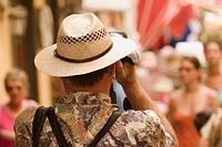 Rear view of a man photographing, Via Padre Reginaldo Giuliani, Sorrento, Sorrentine Peninsula, Naples Province, Campania, Italy