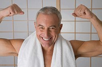 Portrait of a senior man flexing his muscles