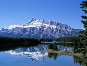 Snowy peak of Mount Rundle reflected in the water of Two Jack Lake, Banff National Park, UNESCO World Heritage Site, Rocky Mountains, Alberta, Canada,...