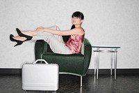 Side profile of a businesswoman sitting in an armchair