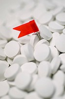 Close_up of a flag on the heap of pills