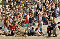 Crowd of people observing a sailing ship parade, Laboe near Kiel, Schleswig-Holstein, Germany