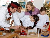 School children train tasting skills with a cook, cooking class, Stuttgart, Baden-Wuerttemberg, Germany