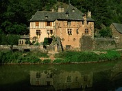 A millhouse reflected in water, near Conques, Aveyron, Midi_Pyrenees, France, Europe