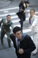 High angle view of business executives chasing a businessman