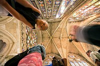 Visitors looking at stained glass windows, cathedral, Leon. Castilla-Leon, Spain