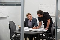 Architects reviewing blueprints