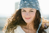 Portrait of smiling woman in stocking cap