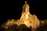 The 19th century Church of San Francisco illuminated at night on Plaza San Francisco in this attractive colonial capital, Cuenca, Azuay Province, Sout...