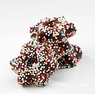 Chocolate stars with coloured sprinkles
