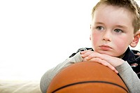 boy (age 6) watching basketball on television