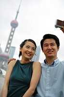 Couple Taking Pitures Of Self At The Bund,Shanghai,China