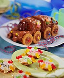 Sweet baking for child´s party: birthday train, name biscuits