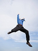 Businessman jumping in mid-air