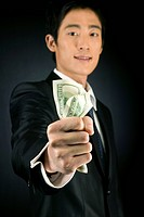 A businessman graping paper money
