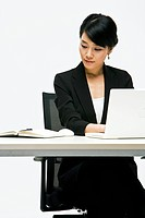 A businesswoman working with a laptop