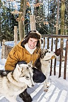Man with sled dogs outdoors during winter
