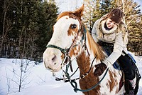 Woman on horse outdoors during winter