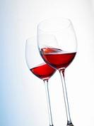 Rosé wine swirling in a glass