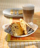 Two pieces of panettone with a glass of milky coffee