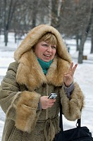 Woman in fur coat Alexander Gardens Moscow Russia