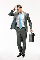 Businessman holding coffee and briefcase