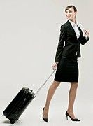 Businesswoman carrying suitcase