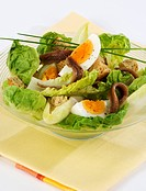 Green salad with anchovies and egg