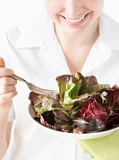 Woman with an Organic Greens Salad