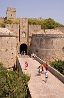 Tourists at the D´Amboise Gate and city walls around Rhodes Town, Rhodes, Dodecanese, Greek Islands, Greece, Europe