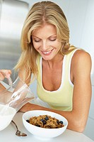 Mid Adult Woman Eating Healthy Breakfast