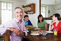 A family sat at a dining table