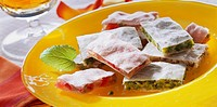 White nut squares with pistachios and cherries
