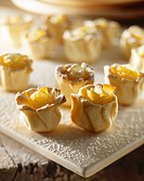 Pastry flowers with cheese cream filling and candied fruit
