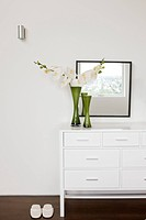 Vase of flowers on bedroom dresser