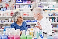 Pharmacist helping customer with over_the_counter products