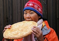Chinese girl eating Chinese bread