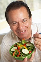 Middle Aged Man Eating Salad