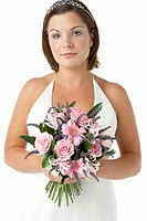 Portrait Of Bride Holding Bouquet Of Flowers