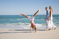 Girl doing handstand at beach