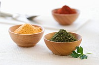 Parsley, Chili Powder and Seasoned Salt in Wooden Bowls